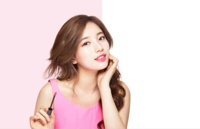 cantora e atriz coreana suzy usando lip tint